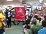 ABA CEO Oren Teicher presents a commemorative banner at Doylestown Bookshop