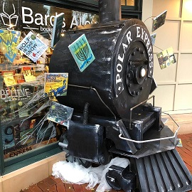 A window display at Bards Alley that features the Polar Express.