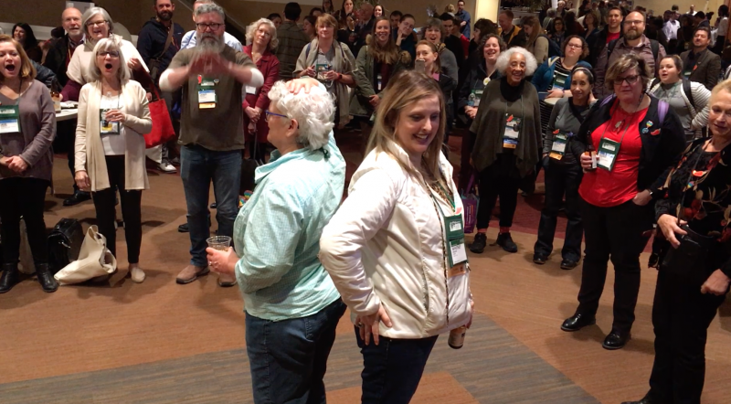 Whitney Balaun (right) won Binc's Heads or Tails fundraising game on behalf of Deon Stonehouse of Sunriver Books, with Sally McPherson of Broadway Books (left) coming in second.