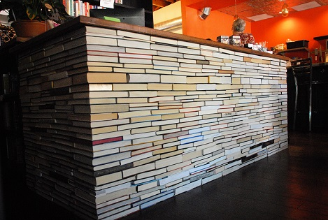 A desk made out of recycled books at BookBar in Denver