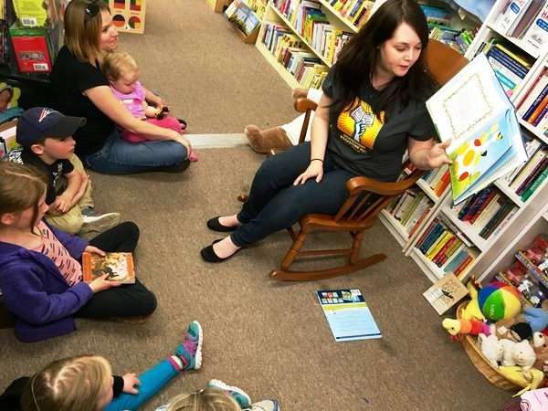 A staffer reads to children at the Briar Patch in Bangor, Maine.