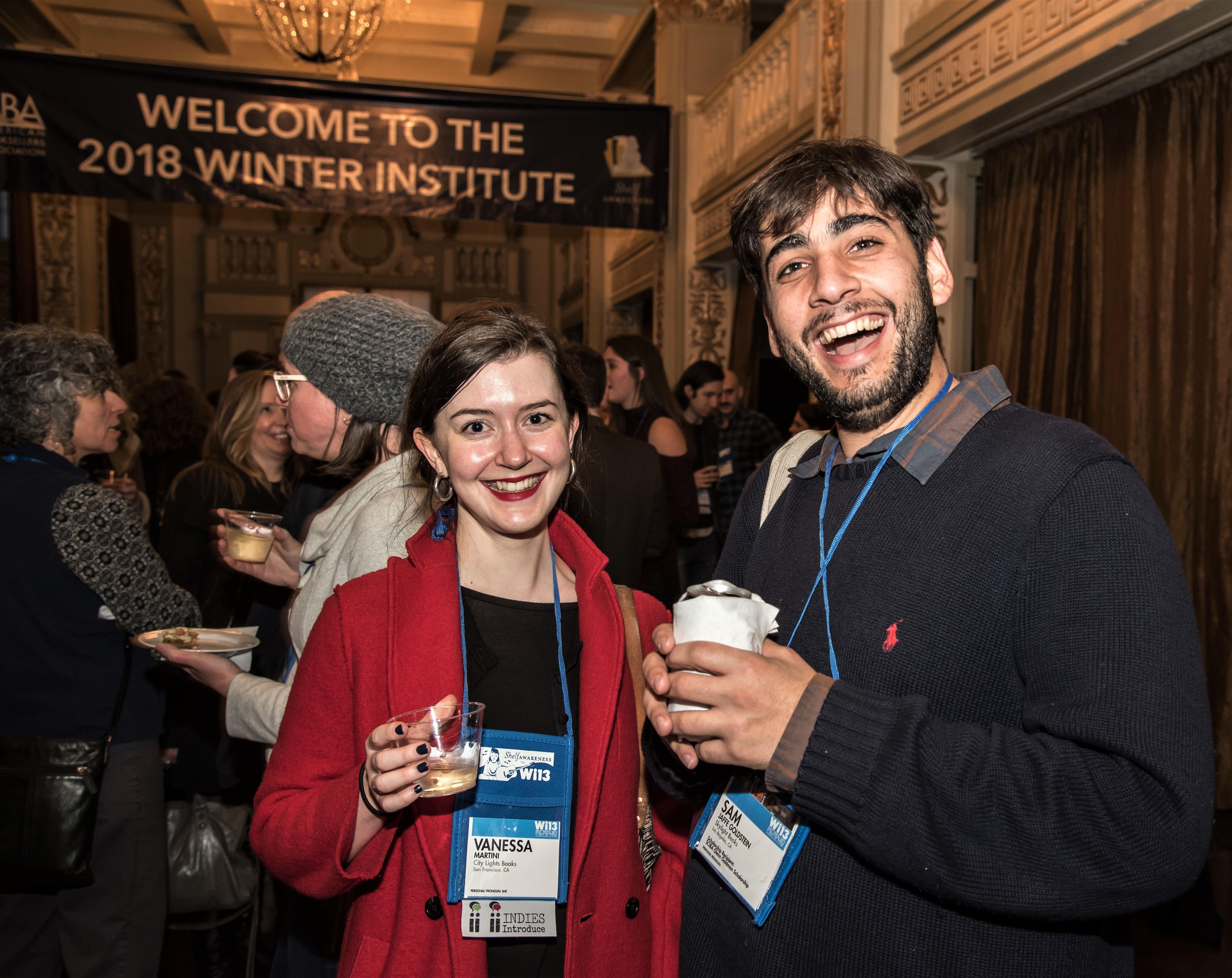 Sam Jaffee Goldstein of Skylight Books socializes with Vanessa Martini of City Lights Books.