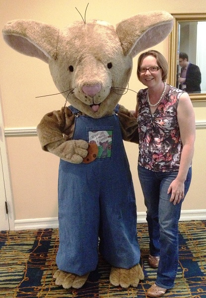 """DIESEL's Claire Doornbos poses with the mouse from """"If You Give a Mouse a Cookie."""""""