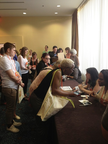 Booksellers meet with members of We Need Diverse Books at the Opening Reception.