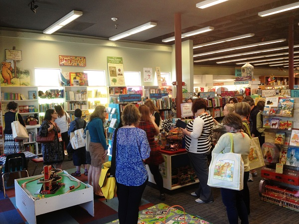 Booksellers peruse the children's section at Vroman's.