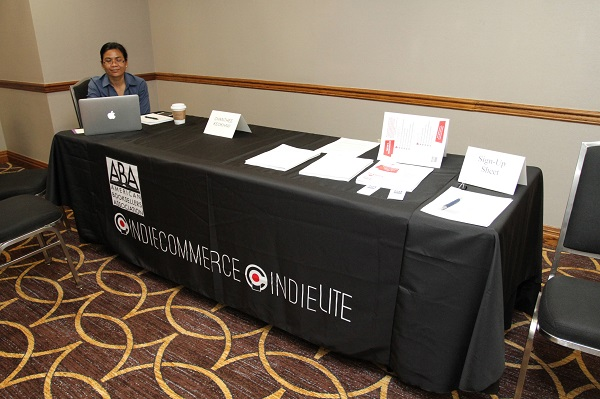 IndieCommerce Specialist Chanthee Keokhaw prepares for a one-on-one with a bookseller.