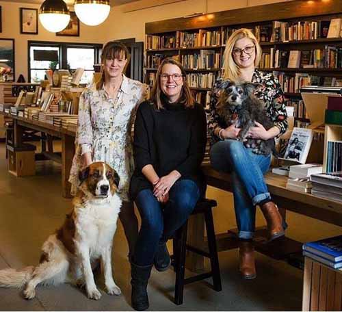 Staff and dogs at Jackson Hole Book Trader