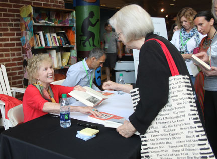 Author Lee Smith greets a fan.