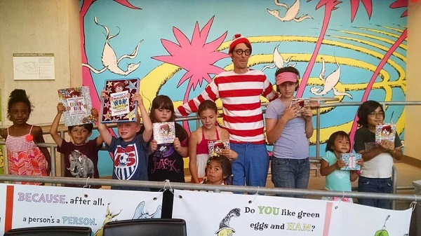 Kids participate in a live Waldo hunt at The Library Shop.