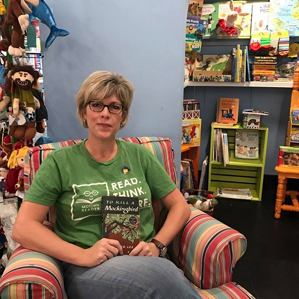 "Midtown Reader owner Sally Bradshaw with ""To Kill a Mockingbird."""