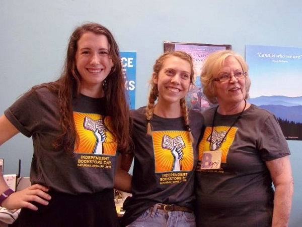 Staffers don IBD T-shirts at Novels & Novelties Bookstore in Hendersonville, North Carolina.