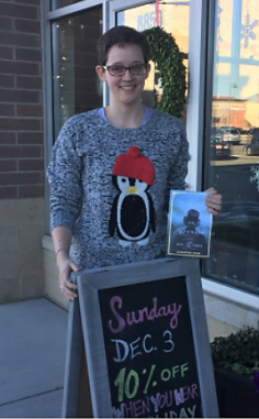 Riverstone Books staffer wearing a holiday sweater