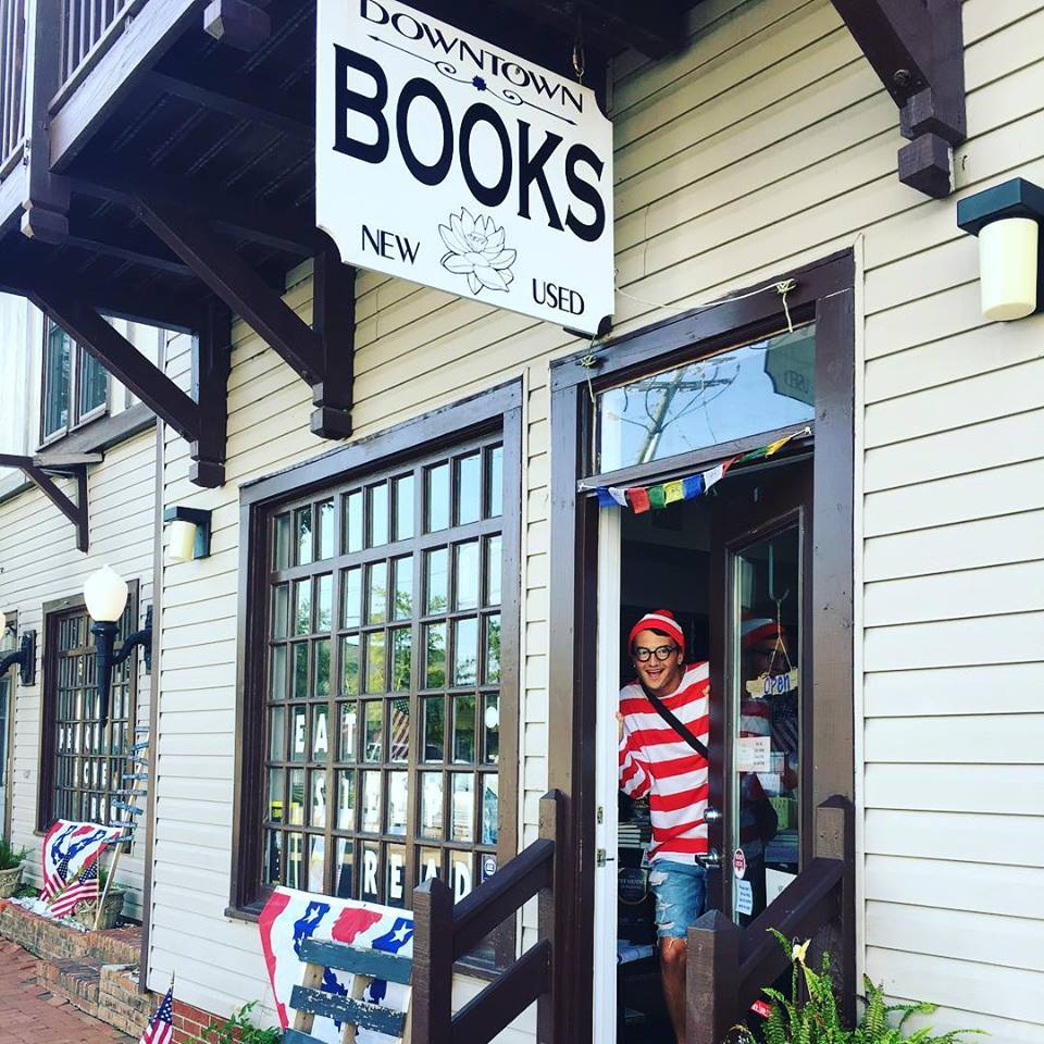 A staff member at Downtown Books in Manteo, North Carolina, dressed as Waldo.