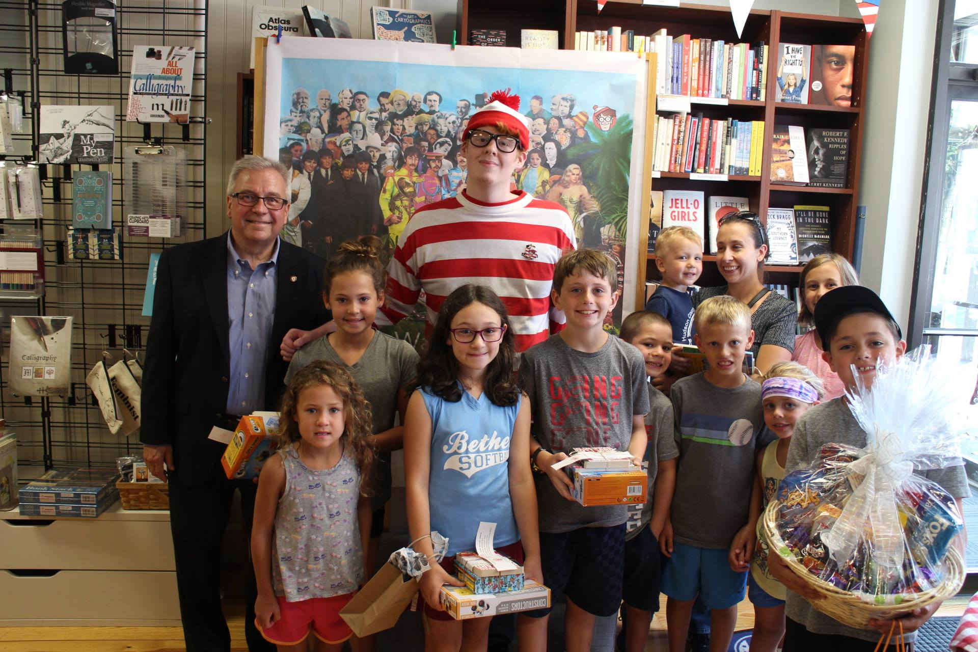 The grand prize winners pose with First Selectman Matthew Knickerbocker at Byrd's Books.