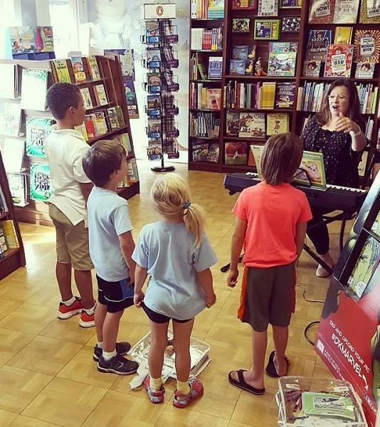 John Cavalier opened the bookstore to community groups, like this Little Mozart class, after the flooding affected 90 percent of his town.