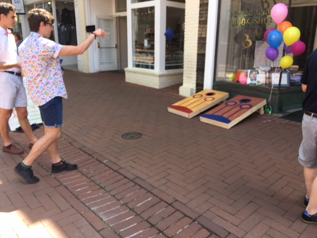 Cornhole players take their shot outside New Dominion Books in Charlottesville, Virginia.
