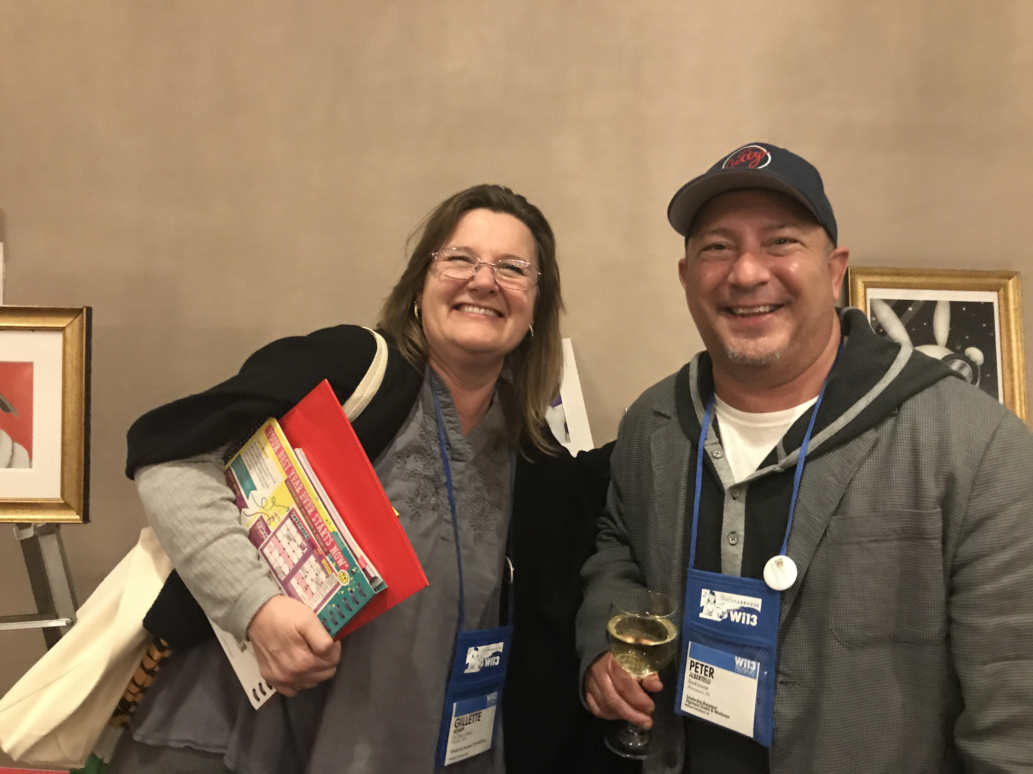 Gillette Kempf renews her friendship with fellow bookseller Peter Albertelli at the Scholastic party.
