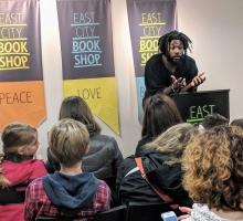 Jason Reynolds speaks with fans at East City Bookshop.