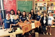 Albuquerque's Sting Force soccer team wraps gifts at Bookworks for Indies First.