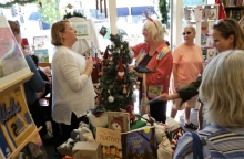 Author Ann Whitford Paul, center, greets shoppers at Once Upon A Time.