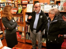 Village Books founders Chuck and Dee Robinson, center and right, stop by Eagle Harbor Book Co. on Bainbridge Island.