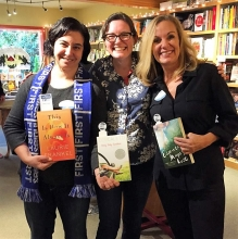 Authors Laurie Frankel, left, and Deb Caletti, right, flank bookseller Tegan Tigani at Queen Anne Book Company.
