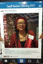 Author Jean Alicia Elster tries out the selfie station at Source Booksellers.