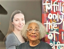Source Booksellers owner Janet Jones poses with a cutout of local business advocate Stacy Mitchell.