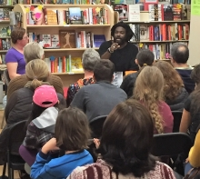 Jason Reynolds talks with readers at One More Page Books.