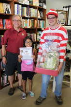 A young customer takes home a basket of prizes at Byrd's Books.