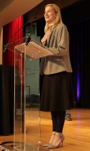 """Ruta Sepetys, author of """"Salt to the Sea,"""" accepts the Young Adult Book of the Year Award."""