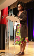 """Yaa Gyasi, author of """"Homegoing,"""" accepts the Adult Debut Book of the Year Award."""