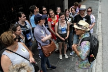 Booksellers follow along on a literary walking tour of the French Quarter.