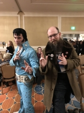 "Obadiah Baird of The Book Bin strikes a pose with ""Elvis"" at the Ingram reception."