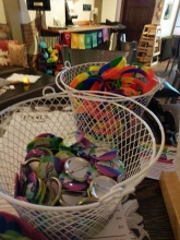 Green Toad offered free Pride buttons and wristbands to customers.