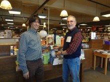 Author Larry Watson lends a hand to Boswell Book Company owner Daniel Goldin.