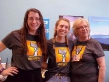 Staffers don IBD T-shirts at Novels & Novelties Bookstore in Hendersonville, North Carolina.