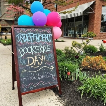 Oblong Books in Rhinebeck, New York, lures in customers with balloons and a colorful sandwich board.