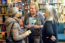 Odyssey Bookshop owner Joan Grenier with author Madeleine Blais and Marge Nott.